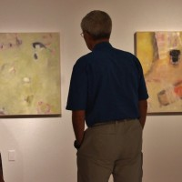 couple admiring contemporary artwork gallery